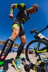 Working it in transition, from bike to run! Photo: Kaori Photography